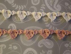 White and a coral heart-shaped garlands