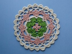 Multicolored coaster in pink, green, and cream