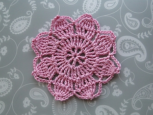 Pink 8 petal flower in a vintage style