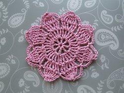 Pink 8 petal flower in a vintage style