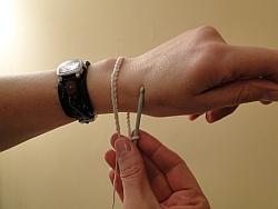 holding bracelet around wrist to check fit