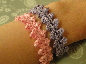 pink and purple bracelets worn side by side