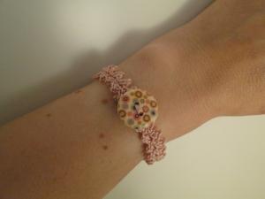 a fine, lacy bracelet with a bigger button