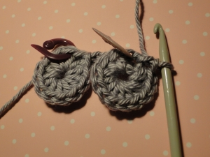 Two wheels crocheted, joined by a chain