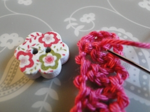 Button ready to be sewn onto bracelet