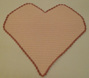 Heart blanket with contrasting edging.