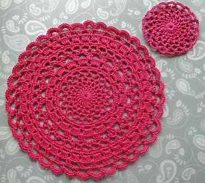 Circular pink lacy crochet doily
