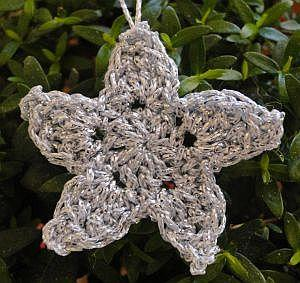 Crocheted star in silver yarn