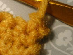 One slip stitch worked in yellow yarn