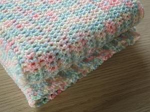An easy crochet baby blanket in variegated yarn