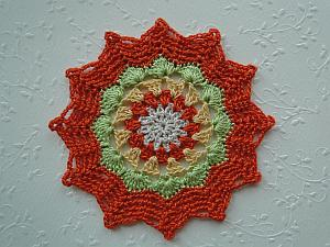 An orange zig zag crochet edging