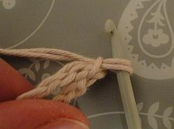 two strands pulled through hook leaving two loops on hook