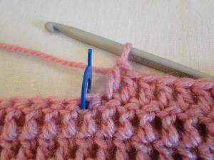 The stitch marker showing the center stitch