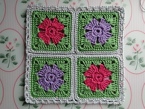 Four flower squares joined and edged with grey