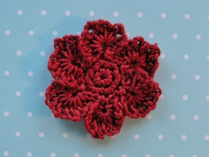 Dark red thread weight yarn used for flower