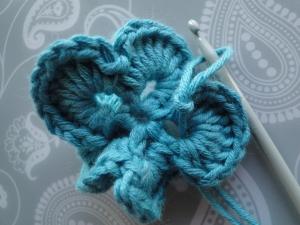 Final slip stitch of flower