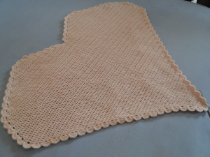 A plain heart blanket, crocheted in one color only.