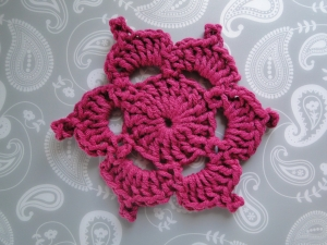 The Picotif worked in aran weight crimson color