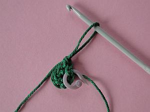 Crochet hook pulling up long loop