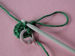 Pulling yarn through stitch