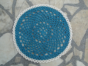 Rep Doily in two colors: warm teal and a cream edging.