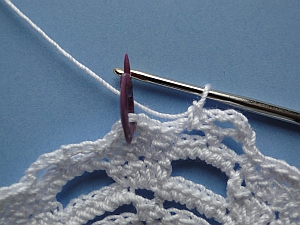 Stitch marker shows where to work the stitch into the center of the crown