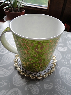 The Royal Coaster with a mug