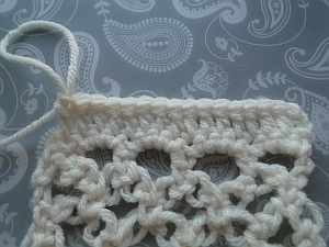 Large stitches worked along edge