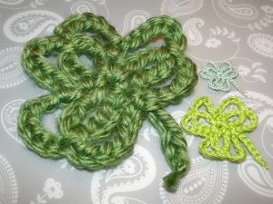 three shamrocks in three different yarn weights