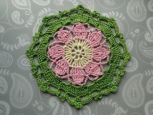 White, pink and green flowery octagon.
