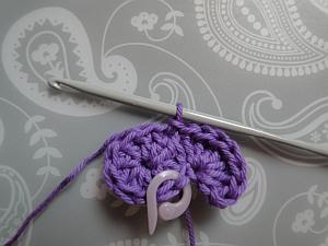 First petal slip stitched onto round 1