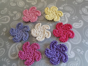 Seven whirly flowers in different colors