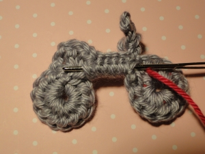 Bringing contrasting yarn across wrong side to next wheel