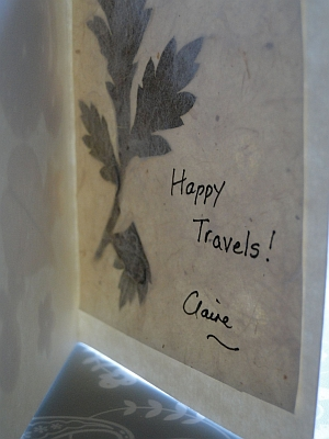 inside of card with leaf and greeting