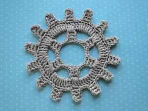Gray gear in double knitting thread.