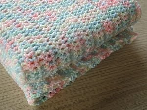 An easy crochet baby blanket in variegated yarn
