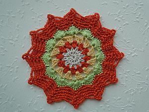 An orange zig zag crochet edging