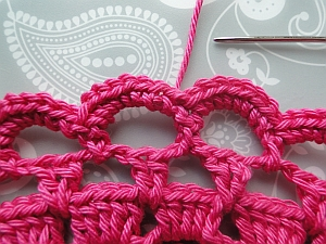 Pull yarn gently then weave into the back