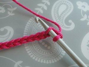Hook under top loop of chain