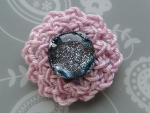 Light pink flower in fingering weight yarn