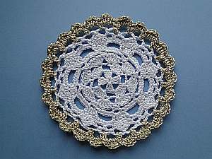 Royal Coaster in white thread with a gold yarn edging