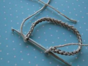 Hook into first slip stitch.