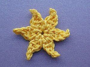 Flaming sun yellow crochet flower
