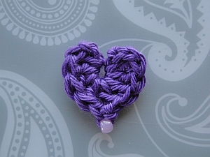 Tiny purple heart with bead at the bottom