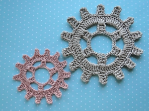 Two steampunk gear wheels next to each other.